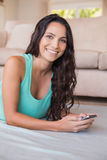 Pretty brunette texting with her smartphone Royalty Free Stock Photos