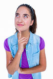Pretty brunette thinking with finger on chin Stock Photography
