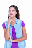 Pretty brunette thinking with finger on chin Royalty Free Stock Photography