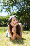 Pretty brunette thinking on the grass Stock Images