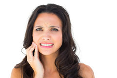 Pretty brunette with a toothache Royalty Free Stock Photography