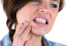Pretty brunette with a toothache Stock Images