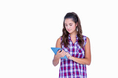 Pretty brunette using tablet computer Royalty Free Stock Image
