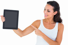 Pretty brunette using tablet pc Royalty Free Stock Photos