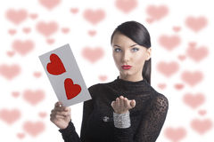 Pretty brunette with valentine postcard send a kiss Royalty Free Stock Photo