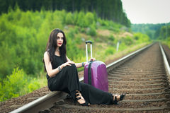 Pretty brunette waiting for train Royalty Free Stock Images