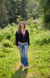 Pretty brunette walking Royalty Free Stock Photos