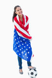 Pretty brunette wearing the american flag with football Stock Images