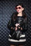 Pretty brunette wearing black jacket Stock Photo