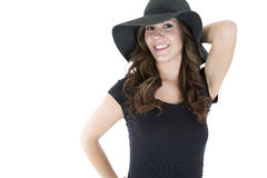 Pretty brunette wearing black t-shirt and sun hat Royalty Free Stock Image