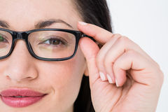 Pretty brunette wearing eye glasses Royalty Free Stock Photos