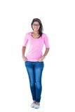 Pretty brunette wearing glasses with hands in pocket Royalty Free Stock Photos