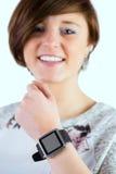 Pretty brunette wearing her smartwatch Royalty Free Stock Photo
