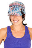 Pretty brunette wearing knit hat and purple tank t Stock Photos