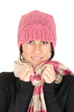 Pretty brunette wearing a pink hat and scarf looki Stock Images