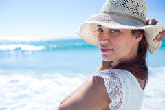 Pretty brunette wearing straw hat and looking at camera Royalty Free Stock Photos