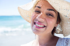 Pretty brunette wearing straw hat and looking at camera Royalty Free Stock Images