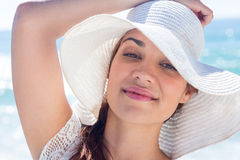 Pretty brunette wearing sunhat and looking at camera Royalty Free Stock Photography