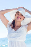 Pretty brunette wearing sunhat and looking at camera Royalty Free Stock Photo
