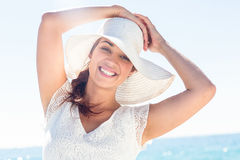 Pretty brunette wearing sunhat and looking at camera Royalty Free Stock Images