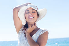 Pretty brunette wearing sunhat and looking at camera Royalty Free Stock Photos