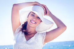 Pretty brunette wearing sunhat and looking at camera Stock Photography