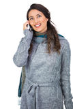 Pretty brunette wearing winter clothes on the phone Royalty Free Stock Photography