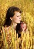Pretty brunette in a wheat. Field Stock Photography