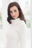 Pretty brunette in white jumper posing Royalty Free Stock Photo