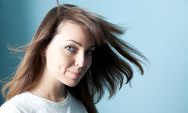 Pretty brunette wind portrait. Fascinating girl looking at camera studio shot Royalty Free Stock Photography