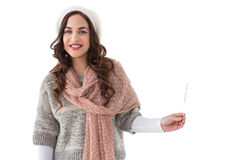 Pretty brunette in winter clothes holding. On white background Royalty Free Stock Photos