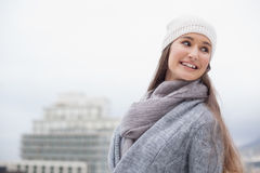 Pretty brunette with winter clothes on Stock Photo