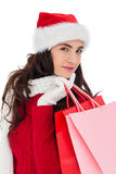 Pretty brunette in winter wear holding shopping bags Stock Image