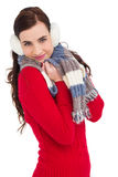 Pretty brunette in winter wear smiling at camera Stock Images