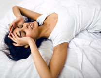 Pretty brunette woman in bed, cant sleep Royalty Free Stock Images