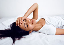 Pretty brunette woman in bed, cant sleep Stock Photo