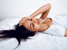 Pretty brunette woman in bed, cant sleep Stock Photography