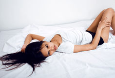 Pretty brunette woman in bed, cant sleep Royalty Free Stock Photos