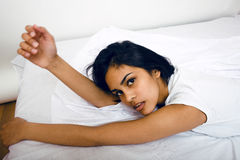 Pretty brunette woman in bed, cant sleep Royalty Free Stock Photography