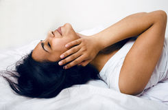 Pretty brunette woman in bed, cant sleep, headache Stock Photography