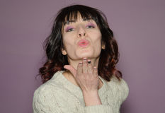 Pretty Brunette woman blowing a kiss Royalty Free Stock Image