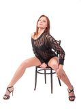 Pretty brunette woman on chair Royalty Free Stock Images