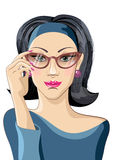 Pretty brunette woman corrects glasses Royalty Free Stock Images