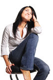 Pretty brunette woman dressed in jeans. White background Royalty Free Stock Photos