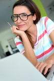 Pretty brunette woman with eyeglasses royalty free stock photos