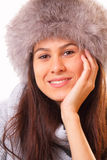 Pretty brunette woman in a fur hat. Pretty and happy young brunette woman in a fur hat Royalty Free Stock Image