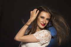 Pretty brunette woman with hair motion Stock Image