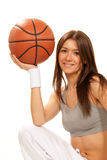Pretty brunette woman holding Basketball in hand Stock Photography