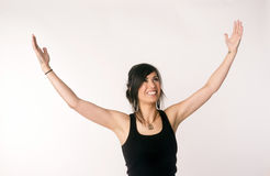 Pretty Brunette Woman Holds Arms Outstretched Jubilant Looking Royalty Free Stock Photography