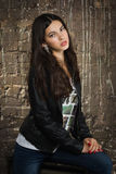 Pretty brunette woman in leather jacket Stock Image